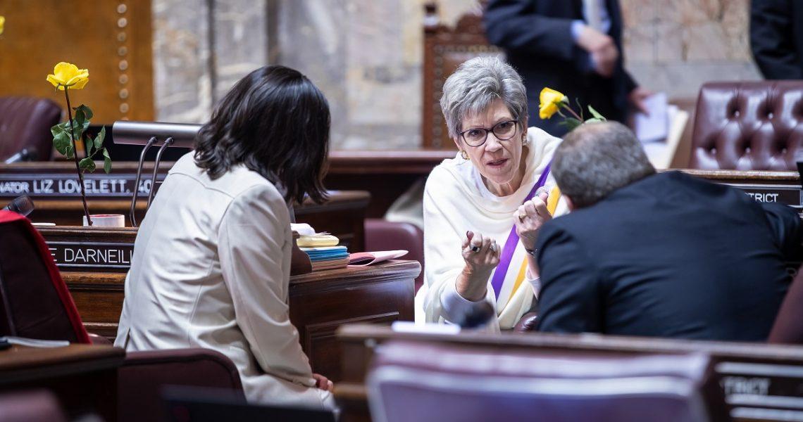 Sen. Darneille talking with two other senators on the Senate floor.