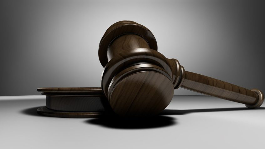 A judge's gavel lies on its side.