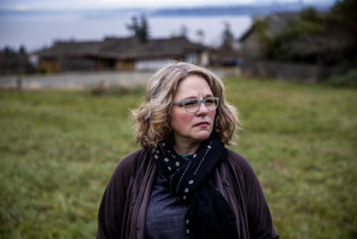 Cheryl Richmond near her home on Vashon Island on Dec. 7, 2020. Richmond saw her car insurance nearly double recently due to a drop in her credit score after missing two mortgage payments. She lost her job in February and, like most people, has been struggling to pay her bills during the pandemic. Washington Insurance Commissioner Mike Kreidler is proposing legislation that would cut the tie between credit scores and insurance rates, which would help ensure people like Richmond, who are struggling financially during the COVID-19 crisis, won't owe more money on their insurance. (Dorothy Edwards/Crosscut)