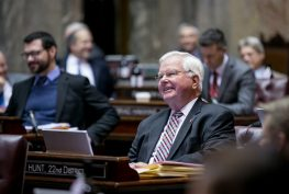 Sen. Sam Hunt smiling on the Senate floor.
