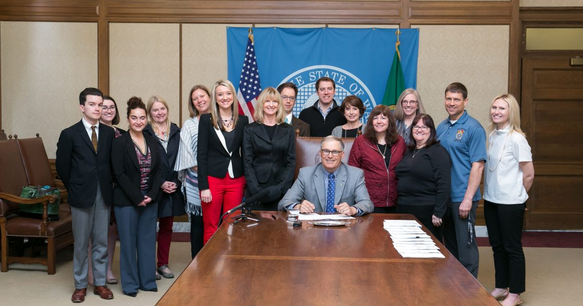 Kuderer's first Senate bill, to help sign language interpreters, signed into law