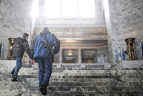 A man open carrying a firearm at the WA State Capitol Building