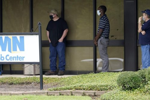 Clients line up outside the state Department of Employment Security WIN Job Center in Pearl, Mississippi. Many state lawmakers are seeking to help workers who are facing financial hardship because of the pandemic.