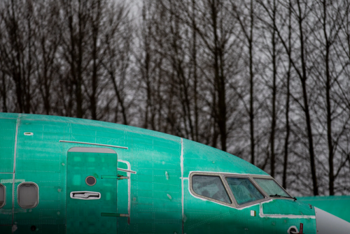 An unpainted Boeing 737 Max at the company's factory in Renton, Wash.Credit...Lindsey Wasson for The New York Times