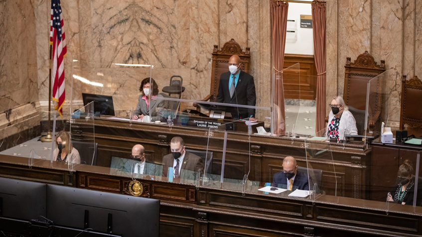 Speaker of the House and staff working on the House floor during debate.
