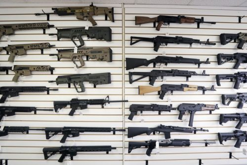FILE - In this Oct. 2, 2018, file photo, semi-automatic rifles fill a wall at a gun shop in Lynnwood, Wash. (Elaine Thompson)