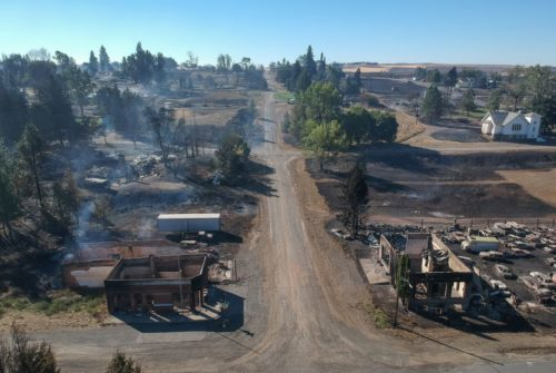 In downtown Malden, Washington, the former post office, lower left, and another historic building, lower right, still smolder Sept. 8, the day after a fast-moving wildfire swept through the town west of Rosalia. (Jesse Tinsley/The Spokesman-Review)