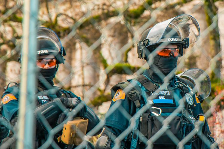 State Troopers sport tactical gear during a rally in Olympia outside the Washington state Capitol building last month. Jared Wenzelburger / jwenzelburger@chronline.com