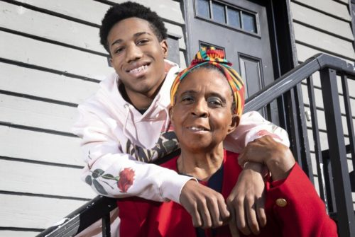 Ollie Reeves, a kinship caregiver and grandmother to Montrey and Destiny, stands outside of her Seattle home with her grandson, Montrey, 14. Most... (Ellen M. Banner / The Seattle Times)