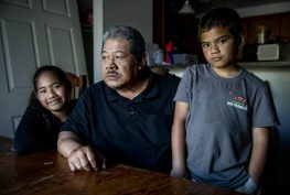 Uli Fuamaila, 73, and his twin 8-year-old grandkids Neamiah, right, and Naomi in their Federal Way home on June 3, 2019. Fuamaila raises the twins, along with his 2-year-old grandson. (Photo by Dorothy Edwards/Crosscut)