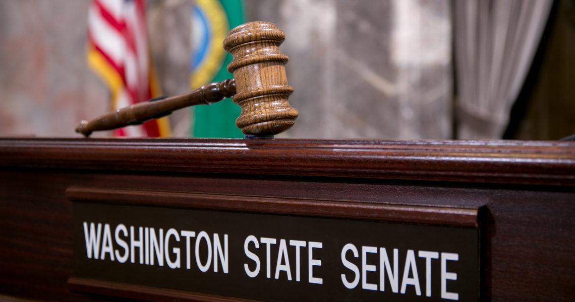 "A gavel above a ""Washington State Senate"" name plate"