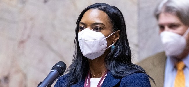 Senator T'wina Nobles wears a mask and speaks from the senate floor in olympia