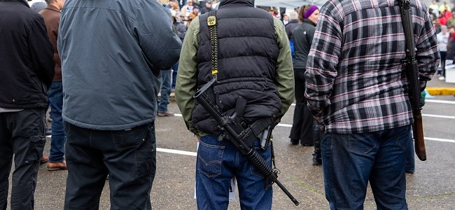 Men with long guns at a protest at the Capitol Campus in Olympia.