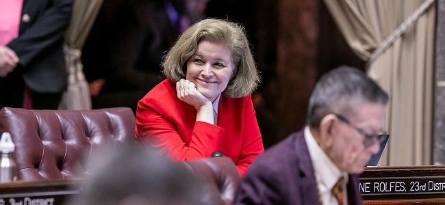 Senator Christine Rolfes smiles on the senator floor in Olympia