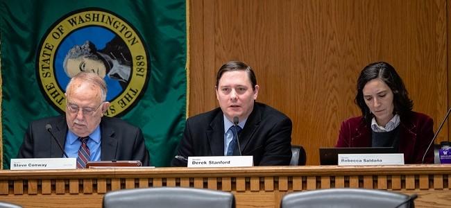 Senators Steve Conway, Derek Stanford and Rebecca Saldana listen during testimony in a committee hearing in Olympia