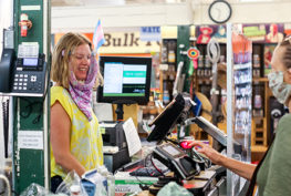 Customer and clerk at grocery store