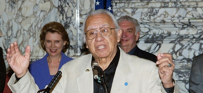 Billy Frank Jr. speaks in Olympia as former Governors Chris Gregoire and Mike Lowry stand behind him