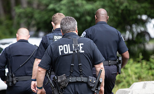 photo of four police officers on duty